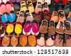 Children shoes on a sidewalk shop - stock photo
