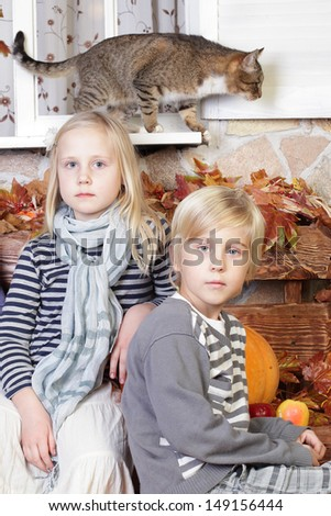 Children sibling - boy, girl and cat - stock photo