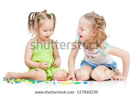 children sisters play together, isolated on white background - stock photo