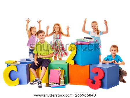 Children sitting at cube hand up. Preschool isolated. - stock photo