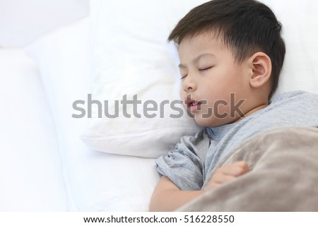 Children sleep on the bedroom,Asian boy sleeping on white bedroom.
