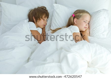 Children sleeping in bed