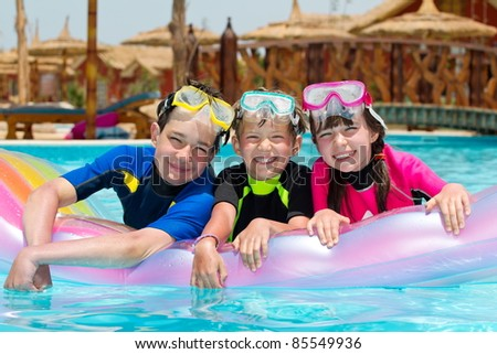 Children snorkeling in pool
