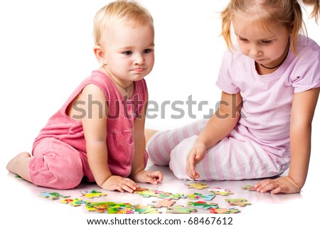 Children solving puzzle