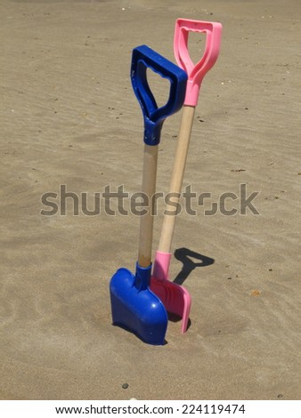 Children spades on a sandy beach.   - stock photo