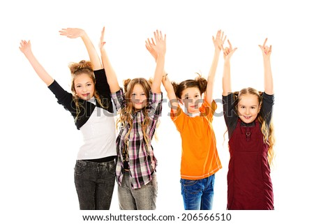 Children stand and wave their hands for joy. Isolated over white. - stock photo