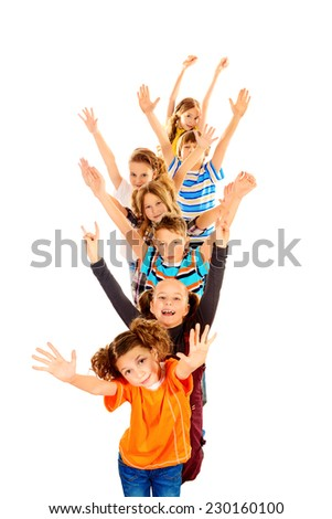 Children stand and wave their hands for joy. Isolated over white.