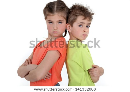 Children standing with arms folded - stock photo