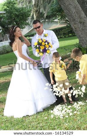 children throwing petals - stock photo