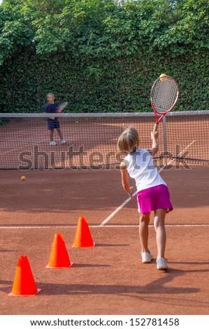 children to tennis school - stock photo