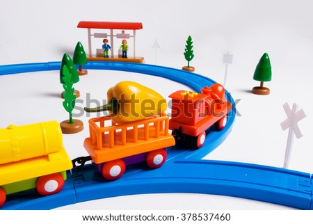 Children toy railway with trains, traffic signs and trees isolated on white background. - stock photo