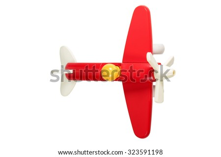Children toy red wooden plane with propellereom and pilot yellow top view isolated on white background - stock photo
