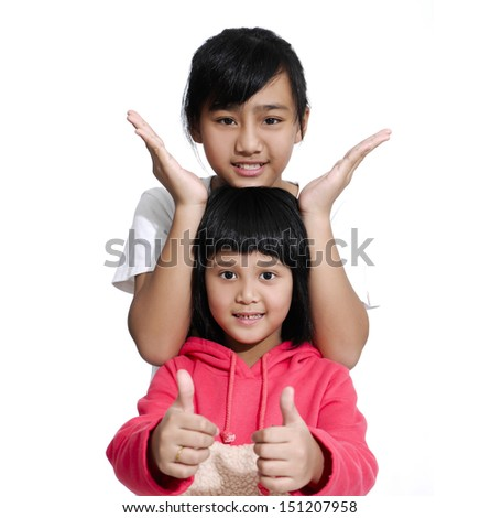 Children Two sisters with their hands up