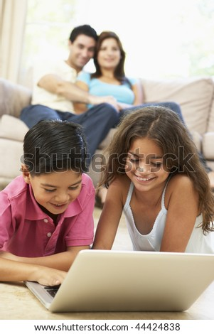 Children Using Laptop At Home - stock photo