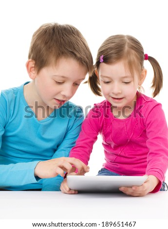 children using tablet computer, isolated over white