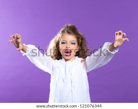 Children vampire makeup kid girl on purple background - stock photo