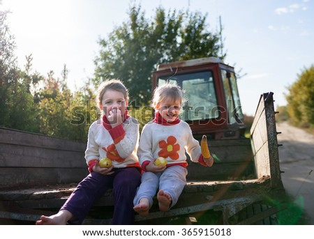 Children walking in   countryside in   tractor trailer
