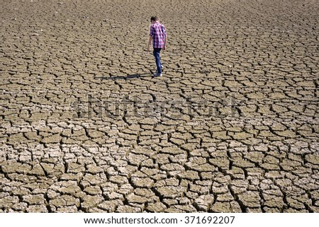 children walking on dry cracked surface