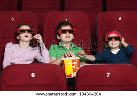 Children watching a  movie at the 3D cinema - stock photo