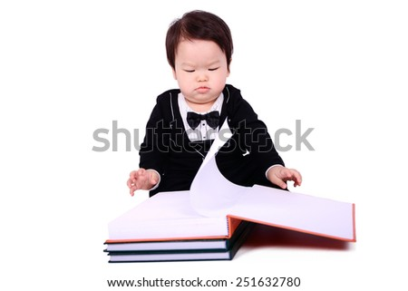 Children wearing a suit, sitting on a white background. - stock photo