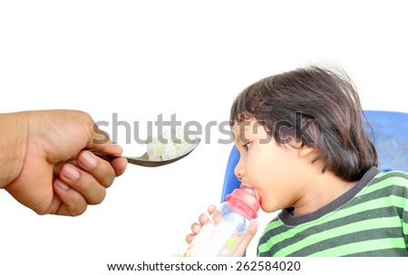 Children who are tired of rice. focus at rice. - stock photo