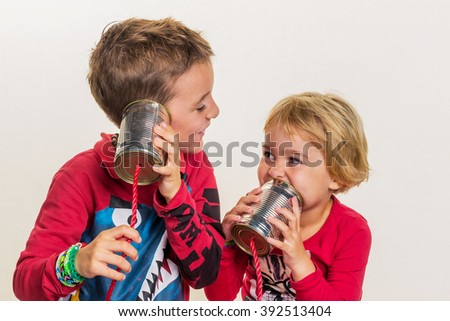 children with a phone - stock photo
