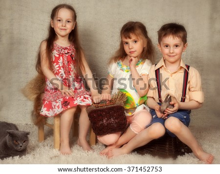 children with a rabbit for Easter