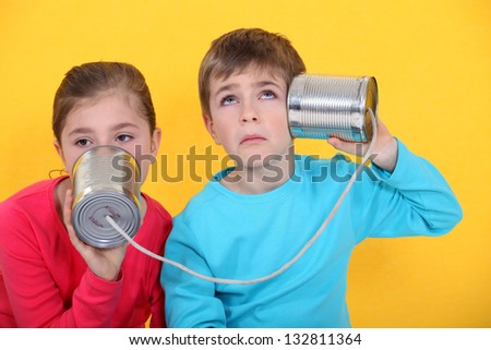 Children with a tin can phone - stock photo
