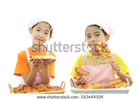 Children with breads - stock photo