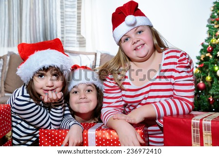children with Christmas presents/Christmas presents - stock photo