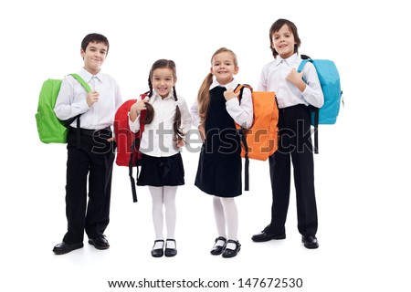 Children with colorful backpacks - back to school theme - stock photo