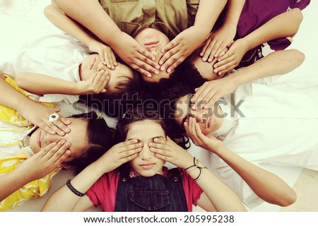 Children with covered blind eyes concept - stock photo