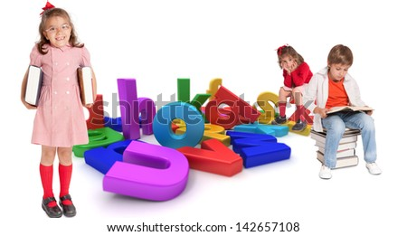 Children with different ages around a multicolored alphabet - stock photo