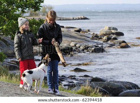 Children with dog - stock photo