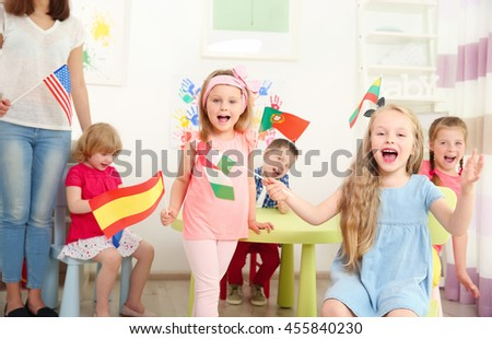 Children with flags in kindergarten