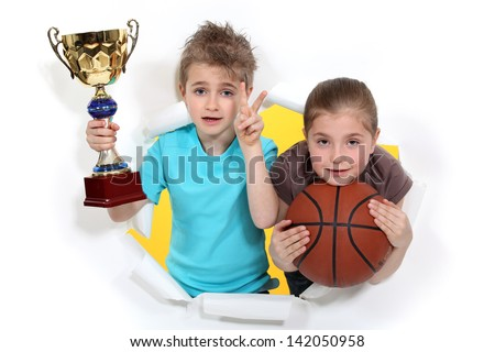 Children with glass and basketball - stock photo