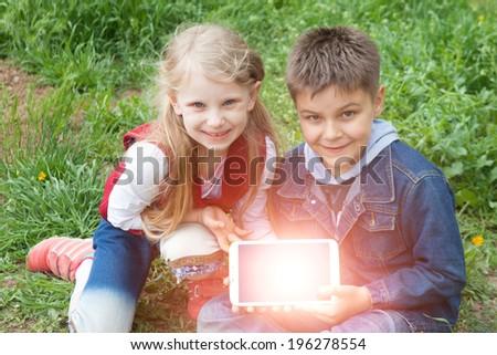 children with iPad - stock photo