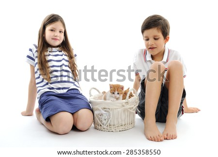 children with kittens - stock photo