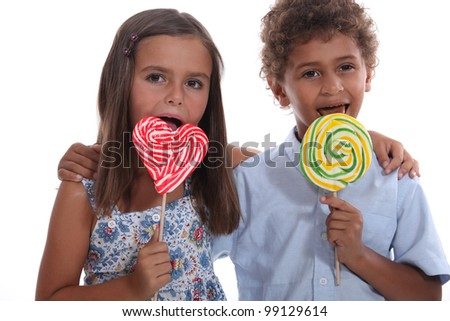 Children with lollipops - stock photo