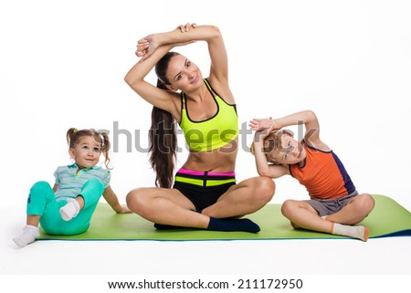 Children with mother doing gymnastic exercises with dumbbells on a white background - stock photo