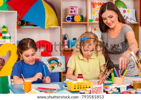 Children with poor eyesight learn to painting . Kids playroom organization of painting and drawing in kid's club. Craft lesson in primary school. Bad sight not obstacle to learning draw.