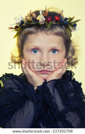 Children with porcelain flowers in studio on light background - stock photo
