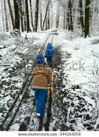 Children with Sledge - stock photo