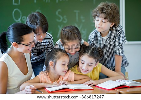 Children with teacher in classroom