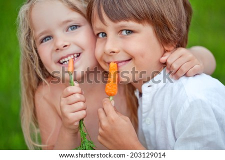 Children with vegetables - stock photo