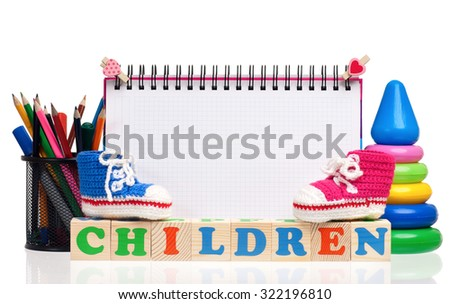 Children word formed by wood alphabet blocks and blank notepad for text, isolated on white background - stock photo