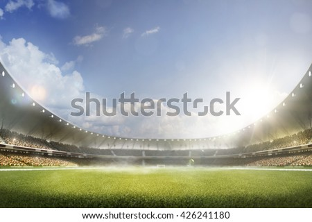Childrens are playing soccer on grand arena - stock photo