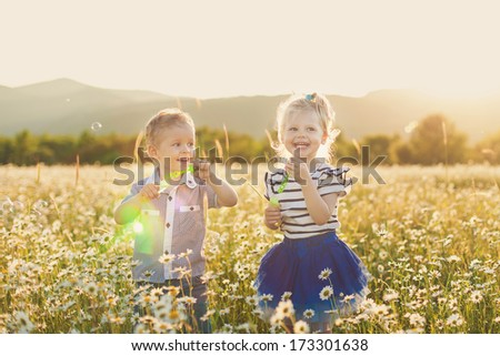 Childrens going in spring field - stock photo
