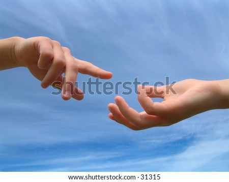 Childrens hands reaching for each other - stock photo
