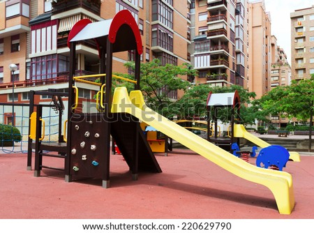 Childrens playground area in city street, nobody - stock photo